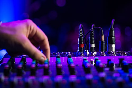 audio visual hire surrey - hand twiddling knobs on audio equipment