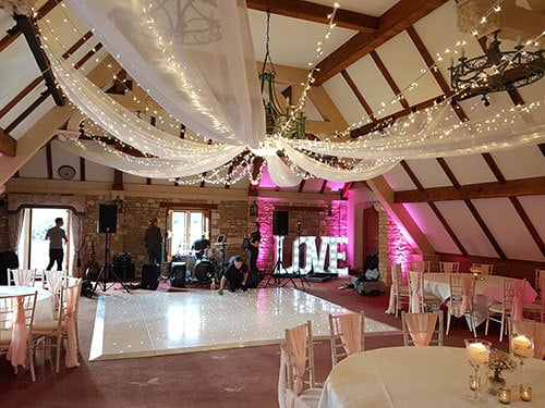 Starlit White Dance Floor Hire London and Surrey with drapery and illuminated letters